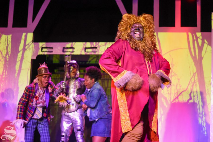 The Lion, played by Alexander Ogborn, sings
