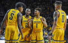 Freshman Tyson Etienne speaks to his teammates in a huddle during the game against Tulane on Feb. 16 inside Charles Koch Arena.