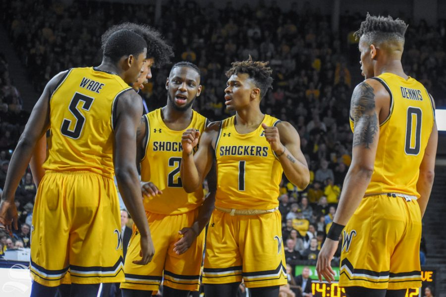 Freshman+Tyson+Etienne+speaks+to+his+teammates+in+a+huddle+during+the+game+against+Tulane+on+Feb.+16+inside+Charles+Koch+Arena.