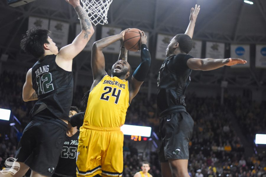 Sophomore+Morris+Udeze+is+fouled+while+going+up+for+a+layup+during+the+game+against+Tulane+on+Sunday%2C+Feb.+16.