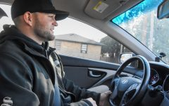 Graduate student Easton Herring answers questions during a drive-along interview with The Sunflower on Jan. 20.