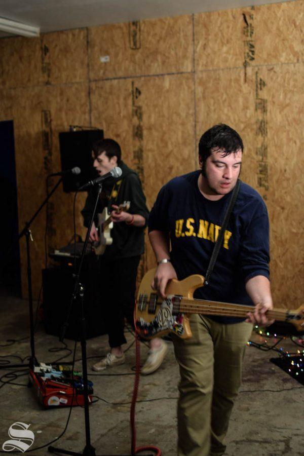 Wichita State student, Chase Crenshaw and band member, Deigo Gomez, perform live Thursday at Kerosene Skate Shop in Downtown Wichita.