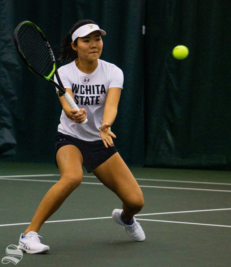 Junior Lingwei goes back and forth with K-State to later win the match with parter Esther Thebault.