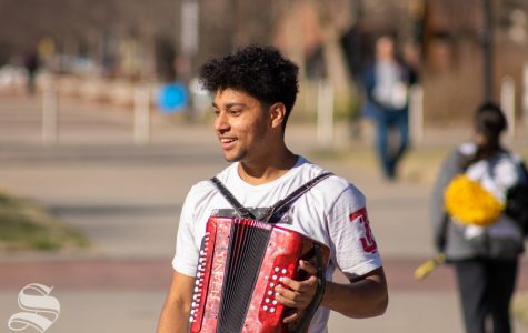 Senior Juan Chandler says that he roller skates around campus while playing the according because
