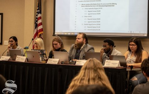 Vice President Michael Bearth oversees debate on a proposed 1.5% student fees increase. The bill ultimately failed and will be sent back to the student fees committee.