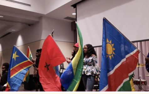 Students participate in a parade of flags at the Taste of Africa event, sponsored by the African Student Association, in November. Confirmed COVID-19 cases hit 1,000 on the continent over the weekend. Only 11 African nations have zero cases of COVID-19 as of Sunday afternoon.