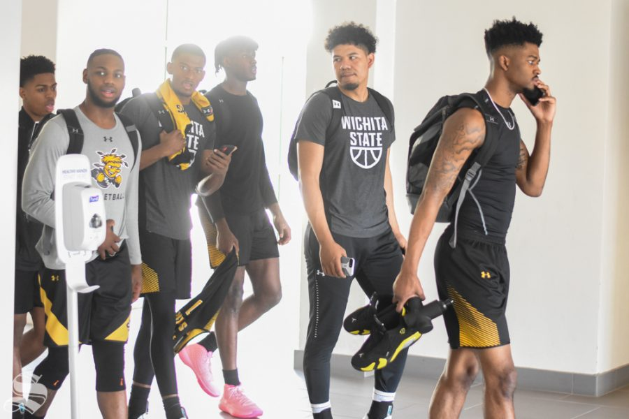 The Wichita State Mens Basketball team walks out of the Texas Wesleyan weight room after hearing the news of the American Athletic Conference cancellation on Thursday, March 12.