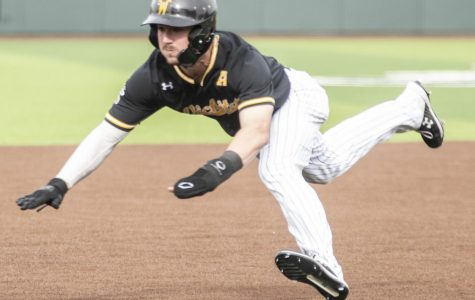 Wichita State's Jack Sigrist dives toward third base during the game against the Air Force Academy at Eck Stadium on Wednesday, March 4, 2020.