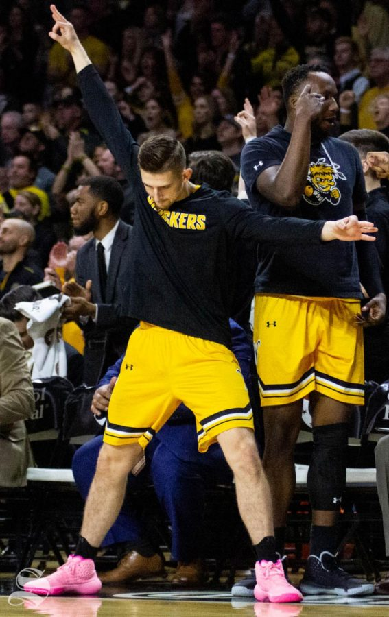 Wichita State sophomore Erik Stevenson celebrates on bench after a made three-pointer during the first half of the game against Tulsa on March 8 inside Charles Koch Arena.