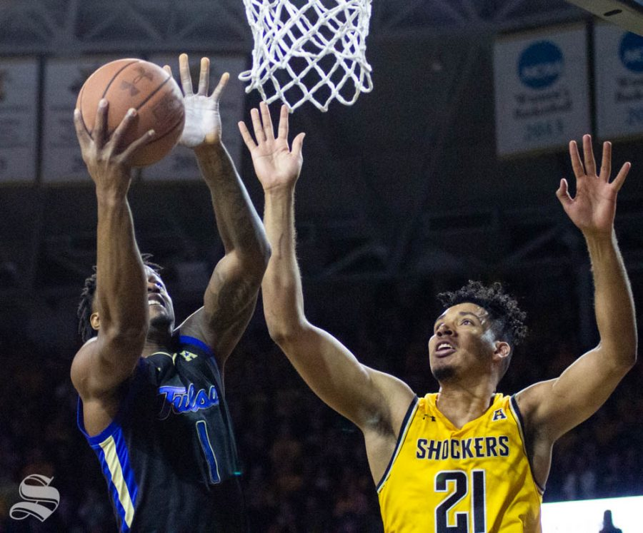 Wichita State senior Jaime Echenique attempts to block a shot during the first half of the game against Tulsa on March 8 inside Charles Koch Arena.