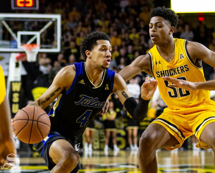Tulsas Isaiah Hill drives past Wichita State freshman Grant Sherfield during the first half of the game against the Shockers on March 8 inside Charles Koch Arena.