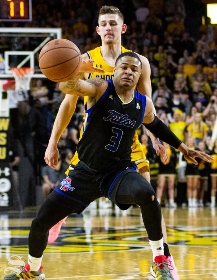 Wichita State sophomore Erik Stevenson pokes the ball away from Tulsas Elijah Joiner during the first half of the game against the Golden Hurricane on March 8 inside Charles Koch Arena.