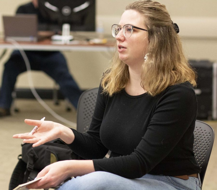 Sunflower Editor-in-Chief Kylie Cameron asks Provost Rick Muma questions during the last weekly briefing of the semester at the Rhatigan Student Center on Thursday, March 19, 2020.
