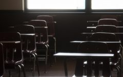 Empty desks in an Elliott Hall classroom on Monday, March 23, 2020.