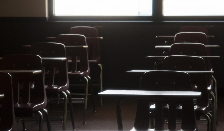 Empty+desks+in+an+Elliott+Hall+classroom+on+Monday%2C+March+23%2C+2020.