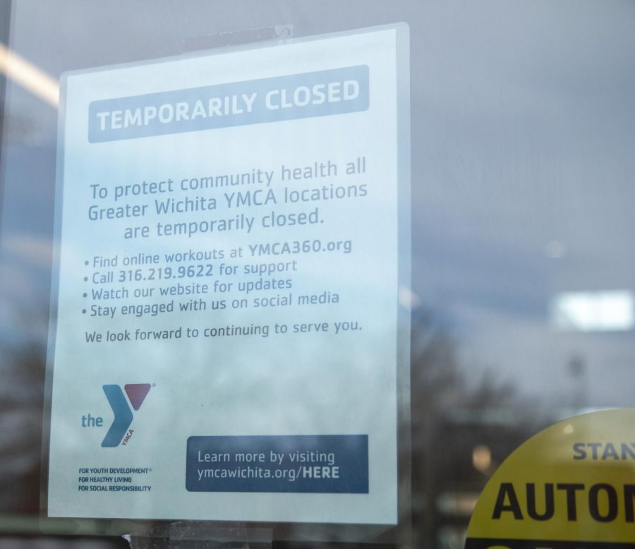 A notice on the doors of the Steve Clark YMCA on campus announces closure of all Wichita locations due to COVID-19.
