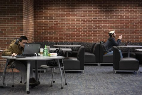 Students study in the Ablah Library on March 23. The library is set to reopen Tuesday.