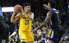 Wichita State senior Jaime Echenique looks to pass the ball during the second half of the game against Tulsa on March 8 inside Charles Koch Arena.