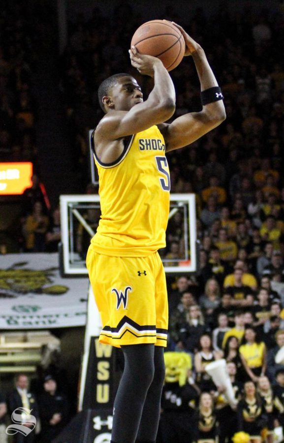 Wichita State junior Trey Wade shoots a three-pointer during the second half of the game against Tulsa on March 8 inside Charles Koch Arena.