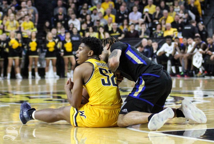 Wichita State freshman Grant Sherfield calls a timeout after grabbing a loose ball during the second half of the game against Tulsa on March 8 inside Charles Koch Arena.