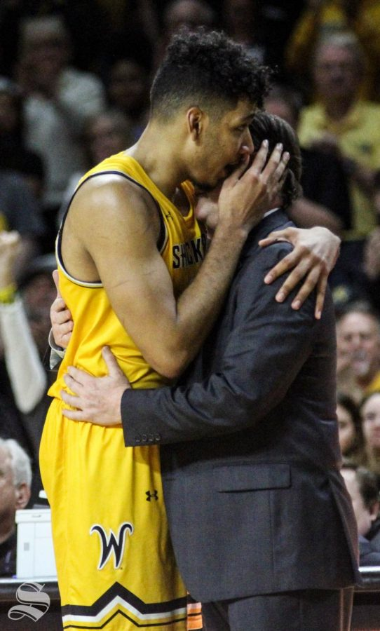 Wichita State senior Jaime Echenique hugs Head Coach Gregg Marshall after subbing out for the final time of his regular season collegiate career during the game against Tulsa on March 8 inside Charles Koch Arena.
