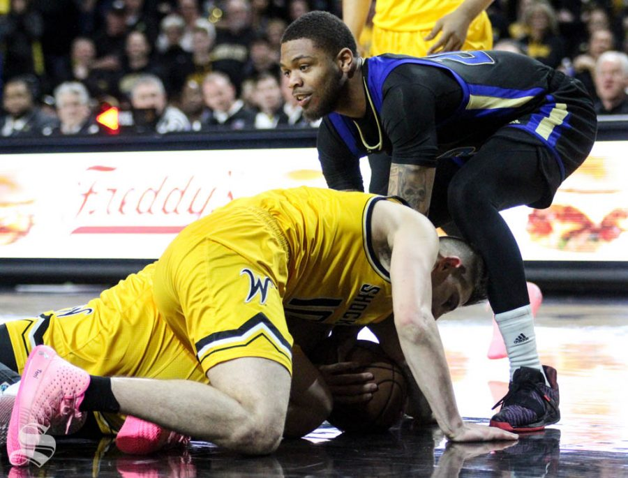 Wichita State sophomore Erik Stevenson fights for a loose ball during the second half of the game against Tulsa on March 8 inside Charles Koch Arena.