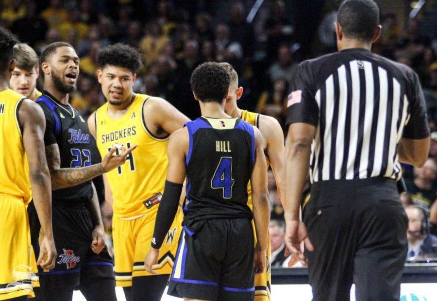 Tulsas Isaiah Hill and Wichita State sophomore Erik Stevenson stand forehead-to-forehead during the second half of the game on March 8 inside Charles Koch Arena. Both players were issued technical fouls.
