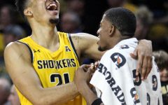 Wichita State senior Jaime Echenique laughs with junior Trey Wade as the clock ticks down in the second half of the game against Tulsa on March 8 inside Charles Koch Arena.