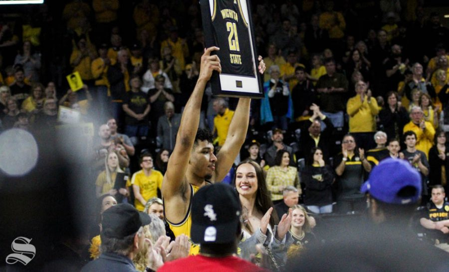 Wichita State senior Jaime Echenique raises his jersey during senior night festivities after the game against Tulsa on March 8 inside Charles Koch Arena.