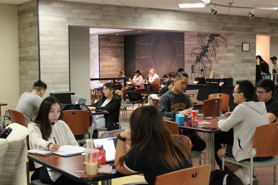Students congregate by the Rhatigan Student Center Starbucks on March 12, 2020.