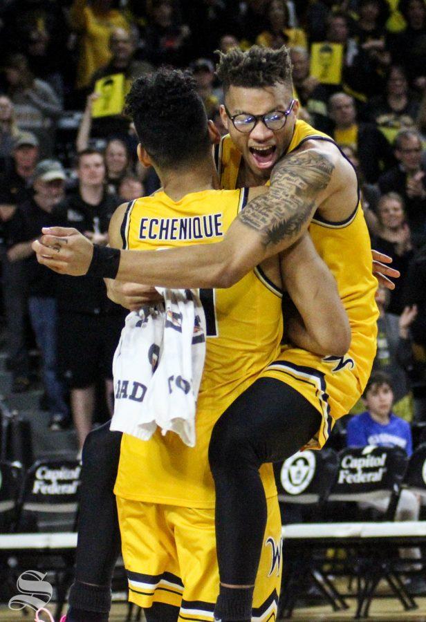Wichita State sophomore Dexter Dennis jumps to hug senior Jaime Echenique after the game against Tulsa on March 8 inside Charles Koch Arena.