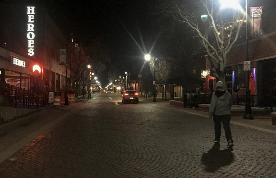 The streets of Old Town are silent but for a few cars or pedestrians on Saturday night, March 21, 2020. Due to COVID-19 many businesses have closed or reduced social gatherings to 10 or less people.
