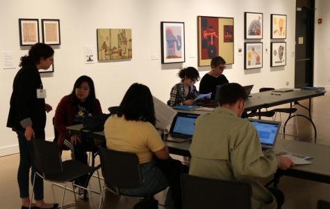Volunteers work to fill in the gaps of information regarding Art and Feminism at the Ulrich Museum's Wikipedia Edit-A-Thon on Friday.