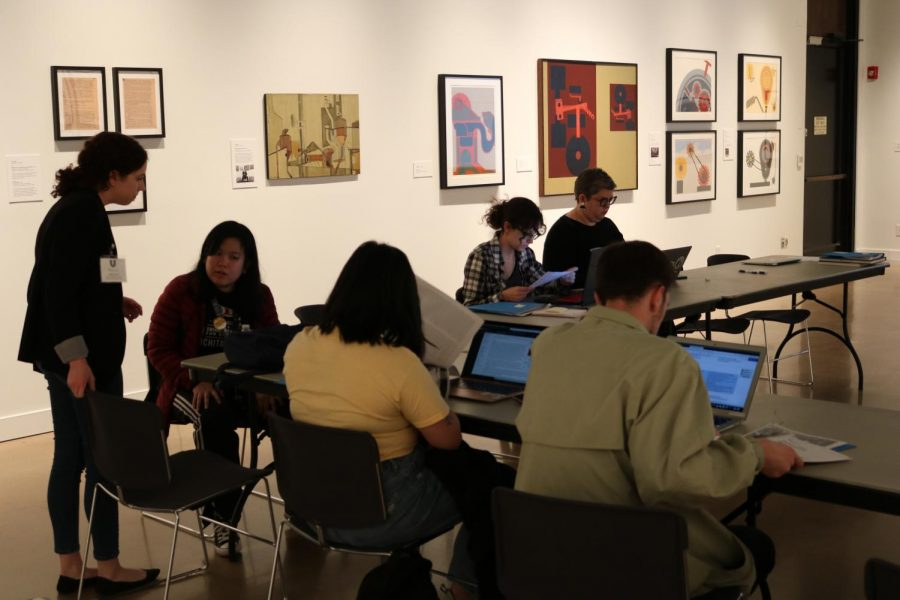 Volunteers work to fill in the gaps of information regarding Art and Feminism at the Ulrich Museums Wikipedia Edit-A-Thon on Friday.