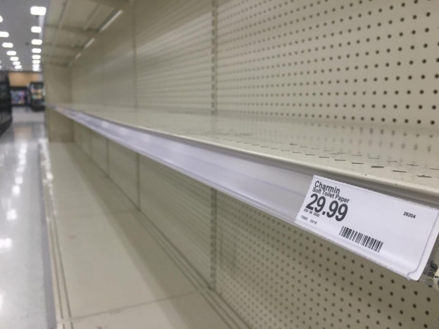 Empty shelves in the toilet paper aisle inside the Target located at 21st and Greenwich on Sunday, March 22, 2020. In reaction to COVID-19, some shoppers have begun hoarding items, causing shortages in paper goods including toilet paper and paper towels at many stores.