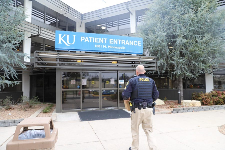 Wichita State Police Sergeant Christopher Tenet delivers a box of personal protective equipment to the University of Kansas Medical Center on March 27, 2020.