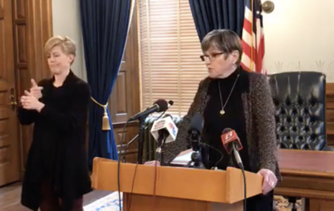 Kansas Gov. Laura Kelly speaks at a media briefing on March 23 announcing the public gathering limit would decrease from 50 to 10.