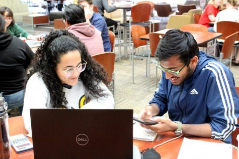 Junior aerospace engineering student Shubhrojit Bhattacharya and freshman mechanical engineering student Irene De Giacomi laugh after reading the COV-19 class suspension update.