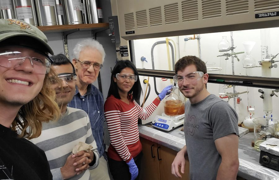 William Groutas, a bioorganic and medicinal chemistry professor at Wichita State (center) and research assistants pose in Groutas's research laboratory at WSU.