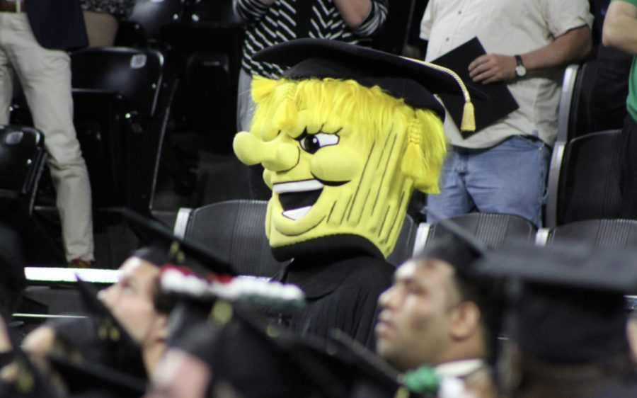 WuShock wears a cap and gown at last May's LAS commencement ceremony.