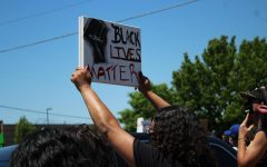 A protester holds a Black Lives Matter sign on Saturday during a protest against police brutality outside of a Wichita Police Department station near Hillside and 21st. The protest is one in a string of demonstrations across the nation after George Floyd was apparently killed by police.