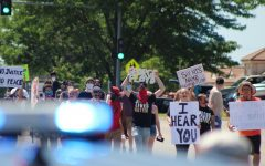 Protesters march on Saturday toward the Wichita Police Department building on 21st Street near Wichita State's campus.
