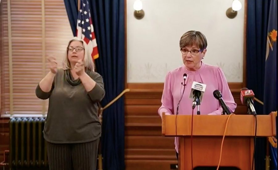 Kansas Governor Laura Kelly speaks on Tuesday at a news conference about the coronavirus. She said the state will move into a