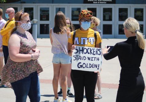 "A student protester holds a sign that says ""Shockers stand with Golden"" during an impromptu rally in support of President Jay Golden on Wednesday afternoon. The rally was organized in response to calls for his resignation after WSU Tech canceled a virtual commencement speech from Ivanka Trump."