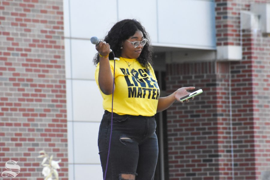 Alyrique Franklin, a junior at WSU, pauses Friday evening during her speech at a Black Lives Matter rally on campus.