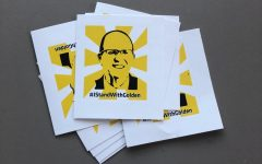 Sierra Bonn, who studies engineering technology management at Wichita State, created #IStandWithGolden stickers and t-shirts. She passed out the stickers last week at the food truck plaza.