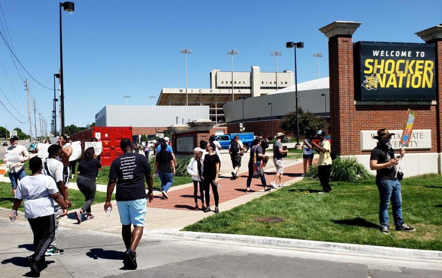 Students and Wichita community members gathered for a protest against police brutality at the Wichita police station near WSU's main campus on Saturday, May 30. Members of the campus community are working with the mayor's civil rights council to address issues like diversity and police brutality.