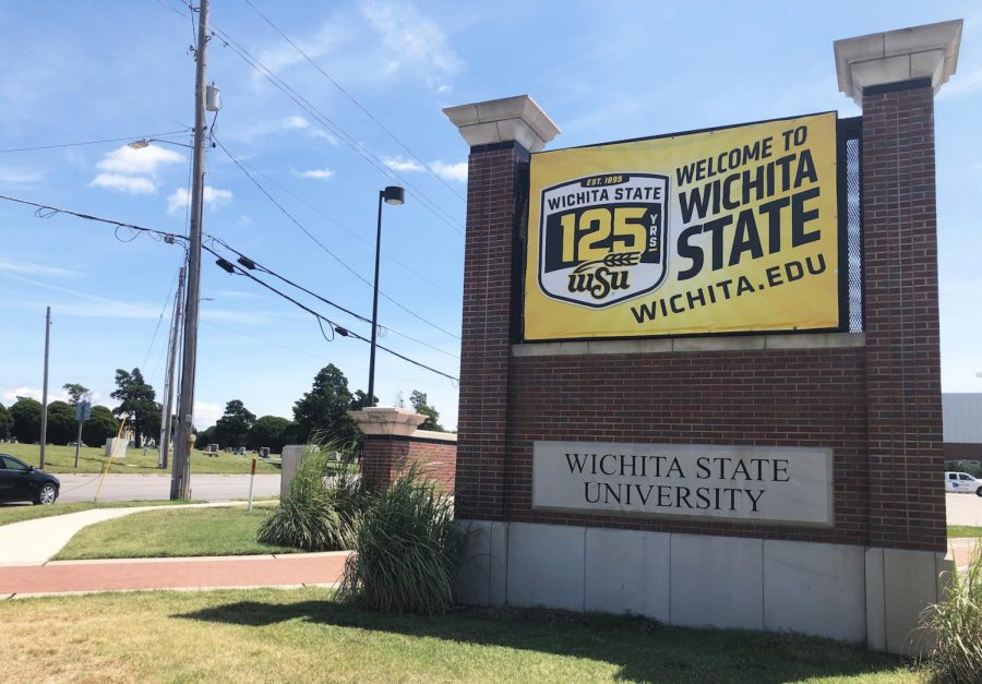 A+banner+celebrating+Wichita+State+University%27s+125th+anniversary+hangs+on+a+university+sign+at+21st+and+Hillside.+WSU+is+planning+a+number+of+events+to+mark+the+anniversary.