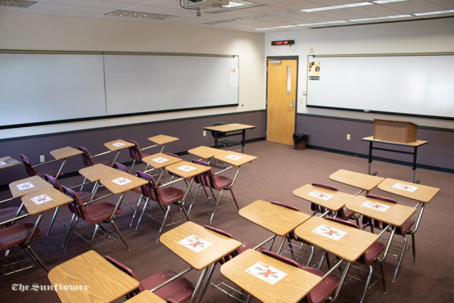 Desks at WSU have different signage promoting social distancing throughout campus. COVID-19 will affect the layout of classrooms.
