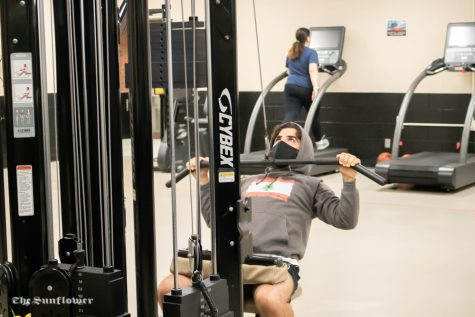 A patron at the Heskett Center works out on Friday. The facility is implementing new measures because of the coronavirus.